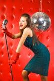 Chanteur de jeune femme Photographie stock