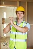 Chantier de Carrying Timber On de constructeur images libres de droits
