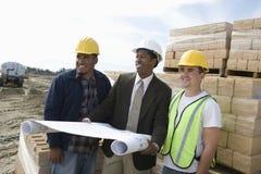 Chantier de construction d'And Workers At d'architecte Images stock