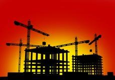 Chantier de construction dans le coucher du soleil Photographie stock libre de droits