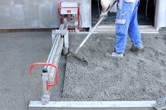 Chantier de construction - plancher courant de laïus de machine Image stock