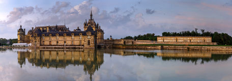 Chantilly castle panoramic view on sunset background Royalty Free Stock Photo