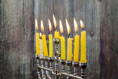 Chanukah candles all in a row. Bright, shiny the Jewish holiday. Stock Photos