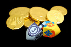Chanukah Dreidels and Gelt on Black Stock Photography