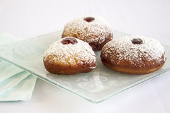 Chanukah Jelly Doughnuts. Hanuka Jelly filled doughnuts on a plate with a white background Stock Photos