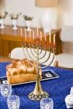Chanukah menorah lit on table. Still life of Chanukah menorah lit on table royalty free stock images