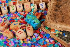 Chanukah wooden dreidels on a wood surface. Side view with the Hebrew letters nun, gimel, hey, shin. Shallow depth of field, drop shadow royalty free stock images