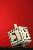 Chanukkah dreidel. Clay chanukkah dreidel on red background Royalty Free Stock Photo