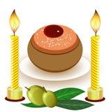 Chanukkahstearinljus med traditionella donuts Arkivfoto