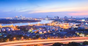 Chao Phraya River, Bangkok metropolitan region, and Bang Kachao. 'green lung' of Bangkok at twilight. Scenic panoramic landscape. Expressway stock photo