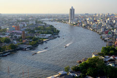 Chao Phraya river curve in afternoon. Choa Phraya river bend with residential area along the banks Royalty Free Stock Image