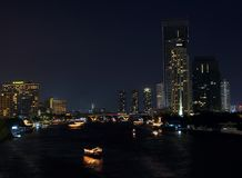 Chao Phraya river at night. The picture shows a view over Bangkoks Chao Phraya river at night. The river is surrounded by towers and skyscrapers and offers a Stock Photography