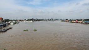 Chao Phraya River in Pakkret. A small ferry-boat crosses Chao Phraya River in the city of Pakkret near the Thai capital Bangkok stock video