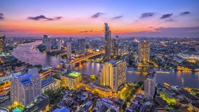 Chao Phraya River and riverside view in twilight time at Bangkok Thailand. Shoot on top of building stock photography