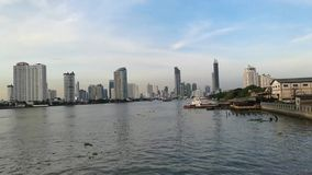 Chao phraya river view in the evening , travel by passenger ship the waterways of Bangkok Thailand