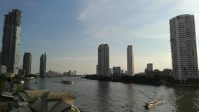 Chao phraya river view in the evening , travel by passenger ship the waterways of Bangkok Thailand. Chao phraya river view in the evening to night , travel by stock footage
