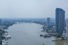 ChaoPhraya River and Bangkok skyline in the evening royalty free stock photo