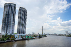 Chaophraya river and Rama VIII bridge view under blue sky Royalty Free Stock Photography