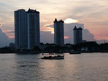 Chaophraya River. Sunset building boat river stock image