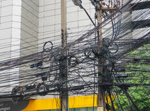 The chaos of cables and wires on asoke road Royalty Free Stock Photography