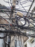 The chaos of cables and wires on asoke road Royalty Free Stock Photos