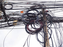 Chaos of cables and wires on electric pole Stock Photography