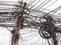 Chaos of cables and wires on electric pole Stock Photos