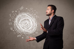 Chaos concept in the hand of a businessman Stock Images