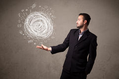 Chaos concept in the hand of a businessman Royalty Free Stock Photo
