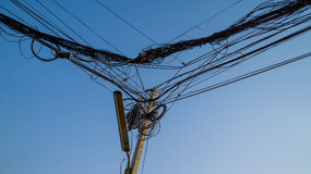 Chaos electric feed and wire on the pole with telecommunication Stock Photo