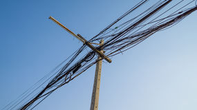 Chaos electric feed and wire on the pole with telecommunication Royalty Free Stock Image
