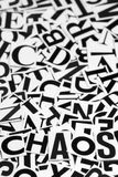 Chaos. Macro shot of a clipped letters formed the word chaos Stock Image