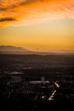 Chaos and Order. Panoramic view of the city of Granada, Genil river and the Vega of Granada at sunset under a cloudy sky making up some reflections Stock Images