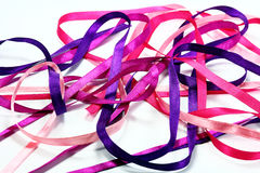 Chaos pink ribbons. All shades of pink color in the woven tapes Stock Image