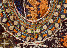 Chaos of stitching thread on surface of Indian patchwork carpet with abstract patterns. Stock Image