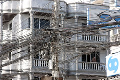 Chaos of wires on the streets Royalty Free Stock Photo