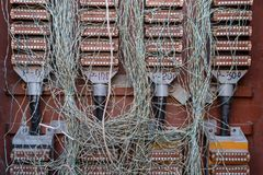 Chaos of wires. Telephone Cable Junction Box. Risk of fire stock images