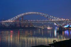 Chaotianmen Bridge at night. The Chaotianmen Bridge is a road-rail bridge over the Yangtze River in the city of Chongqing, China. The bridge, which opened on 29 Stock Photography