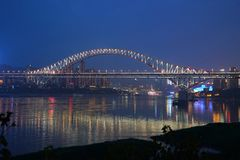 Chaotianmen Bridge at night. The Chaotianmen Bridge is a road-rail bridge over the Yangtze River in the city of Chongqing, China. The bridge, which opened on 29 Royalty Free Stock Photo