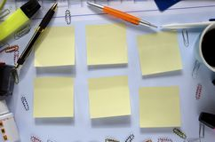 Chaotic desk, free copy space on sticky notes Royalty Free Stock Photo