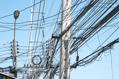Chaotic electric wiring in Thailand Royalty Free Stock Photography