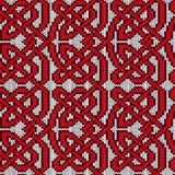 Chaotic interlaced knitted pattern. Chaotically interlaced red lines on the white background, seamless vector knitting pattern as a fabric texture Royalty Free Stock Images