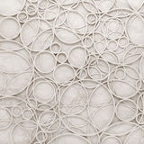 Chaotic intersected relief circles pattern over paper texture Royalty Free Stock Photos