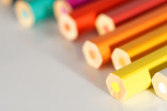 Chaotic line of colorful pencils Stock Images