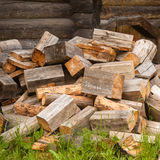 Chaotic pile of firewood logs lying Royalty Free Stock Photos
