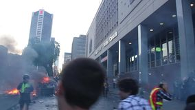 Chaotic riot scene with fire and tear gas bombs