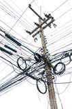 Chaotic tangle of wires on electric post. Isolate on white Royalty Free Stock Photography
