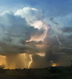 A Chaotic Thundercloud with Lightning Strikes Within Stock Photography