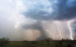 A Chaotic Thunderstorm with Lightning Strikes Within Royalty Free Stock Images
