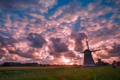 Chaotic windmills sunset with free place for message Royalty Free Stock Photos